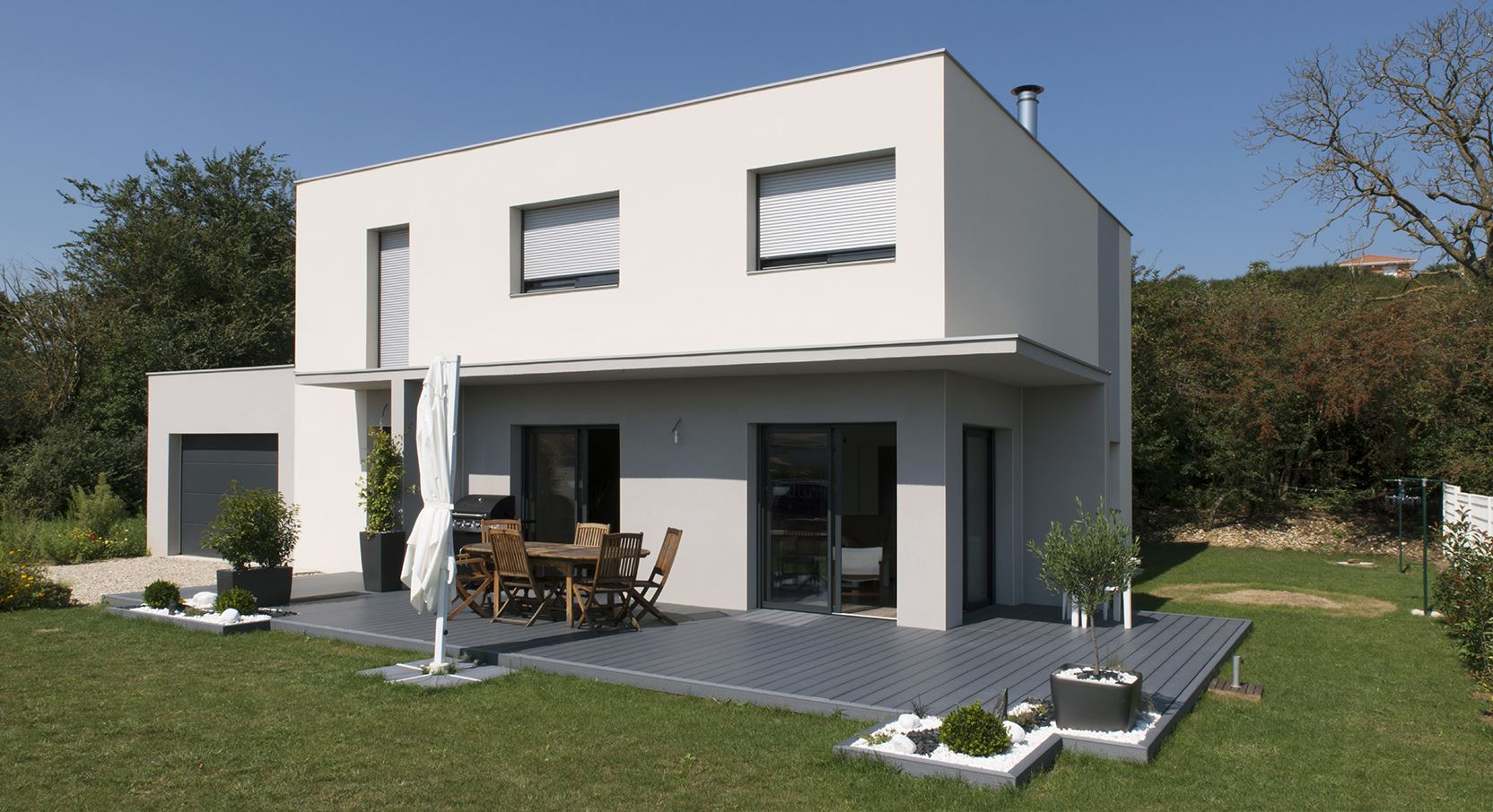 Photo maison contemporaine mc immo for Plan maison architecte moderne